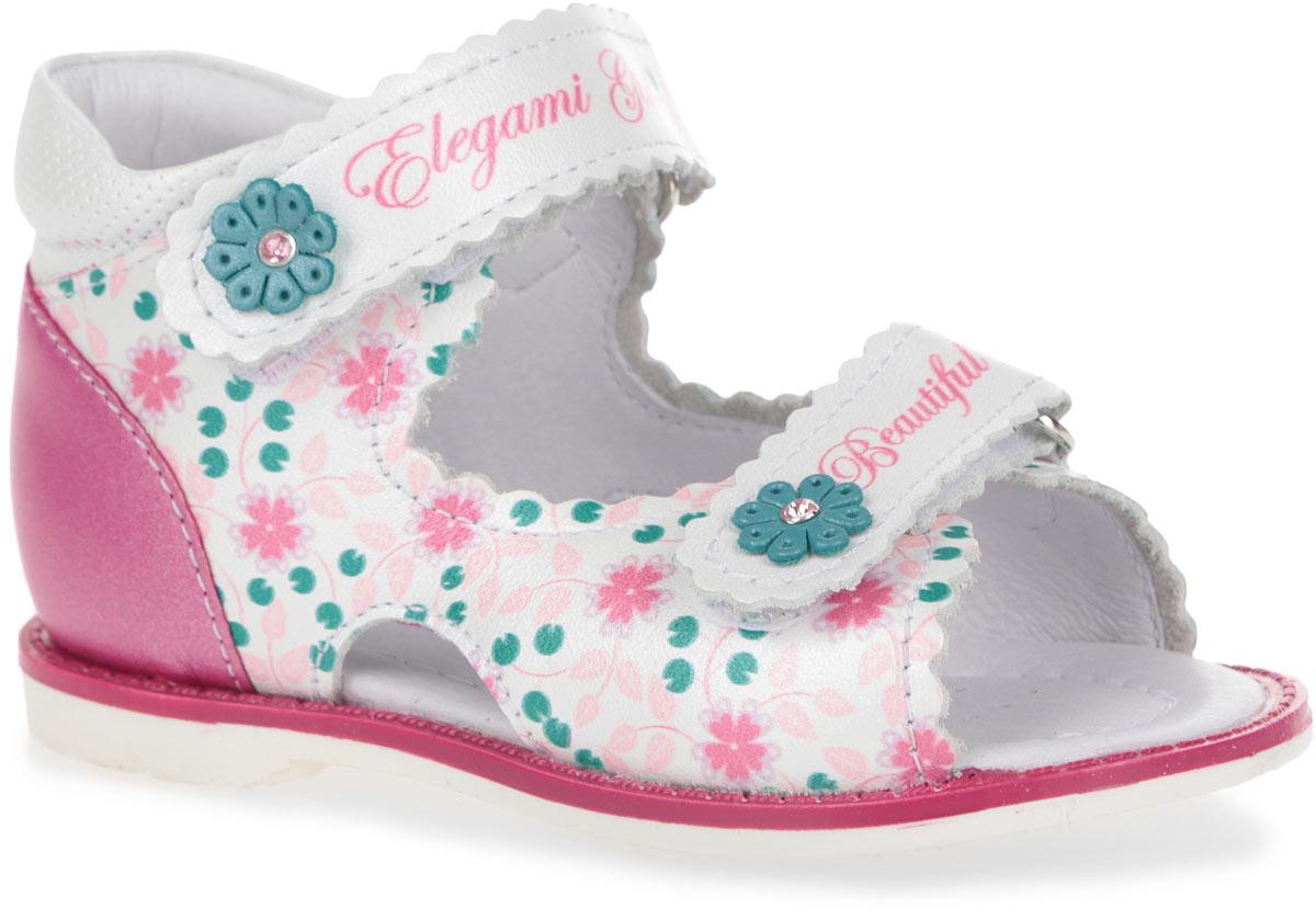 7-805721501Прелестные сандалии от Elegami очаруют вашу девочку с первого взгляда! Модель выполнена из натуральной кожи с цветочным принтом. Ремешки на застежках-липучках украшены аппликациями в виде цветов, сердцевина которых декорирована стразами. Закрытый задник и фиксирующие ремешки обеспечивают оптимальную посадку обуви на ноге, не давая ей смещаться из стороны в сторону и назад. Стелька из натуральной кожи дополнена супинатором, который обеспечивает правильное положение ноги ребенка при ходьбе, предотвращает плоскостопие. Перфорация на стельке позволяет ногам дышать. Рифленая поверхность подошвы защищает изделие от скольжения. Яркие стильные сандалии поднимут настроение вам и вашей дочурке!