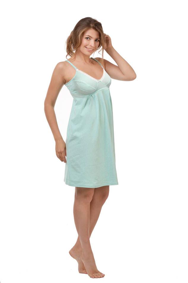 Ночная рубашка24127Удобная, красивая ночная сорочка для беременных и кормящих мам Мамин Дом, изготовленная из натурального хлопка с добавлением эластана, женственна и элегантна. Модель на тонких бретелях оформлена очаровательным принтом в мелкий горох, а чашечки украшены кружевной вставкой. Бретельки регулируются по длине. Чашки сорочки легко отстегиваются, благодаря пластиковым клипсам, что позволяет в любой момент быстро и легко покормить малыша. Свободный крой позволяет носить ночную сорочку как во время беременности, так и после родов. Такая сорочка сделает отдых будущей мамы комфортным. Одежда, изготовленная из хлопка, приятна к телу, сохраняет тепло в холодное время года и дарит прохладу в теплое, позволяет коже дышать.