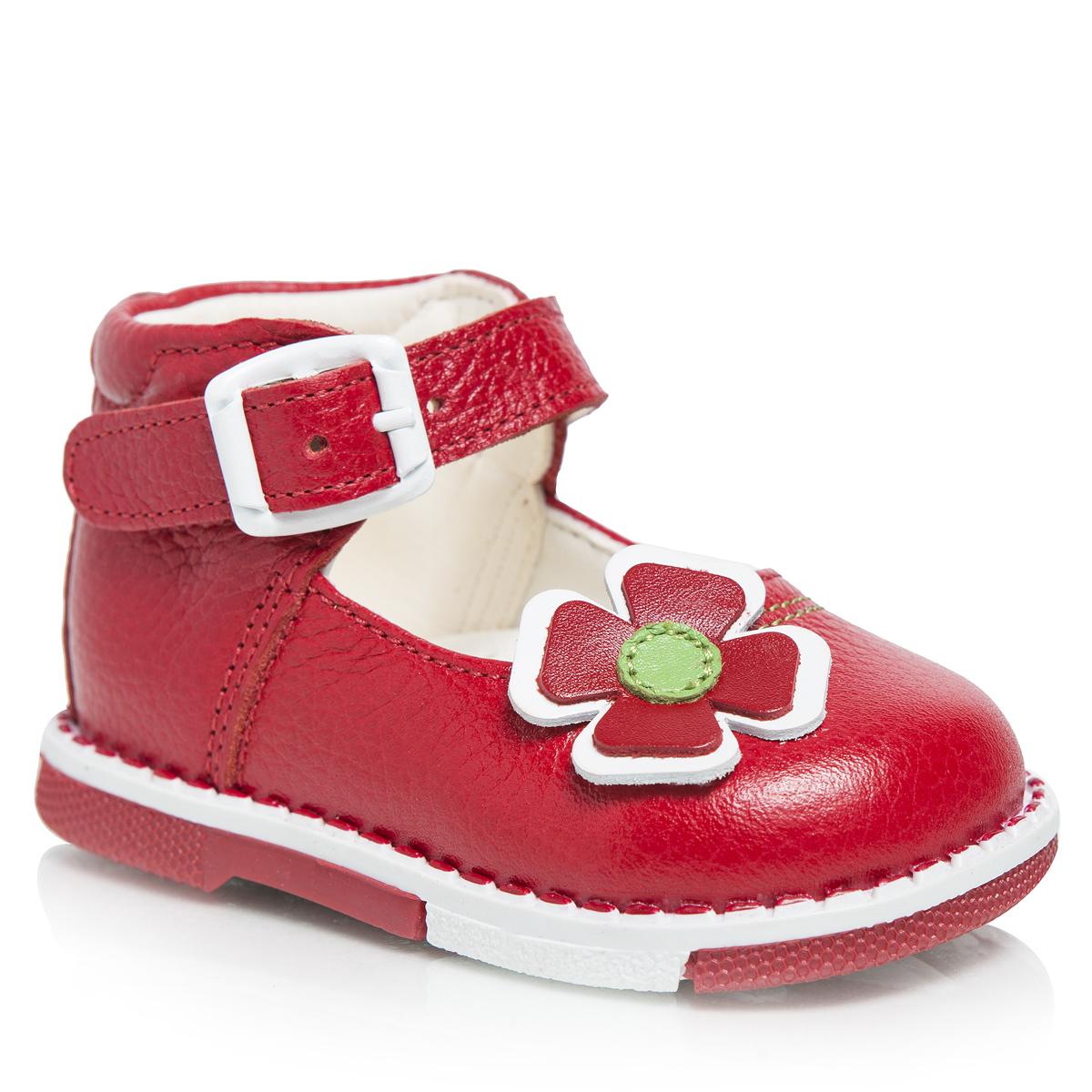 Туфли для девочки. 122122-121Прелестные туфли от Таши Орто очаруют вашу малышку с первого взгляда! Модель выполнена из натуральной высококачественной кожи и оформлена прострочкой, задним наружным ремнем, аппликацией в виде двойного цветочка. Полужесткий закрытый задник и ремешок с застежкой-пряжкой надежно фиксируют ножку ребенка, не давая ей смещаться из стороны в сторону и назад. Длина ремешка регулируется за счет болта. Стелька из натуральной кожи дополнена супинатором с перфорацией, который обеспечивает правильное положение ноги ребенка при ходьбе, предотвращает плоскостопие. Ортопедический каблук, продленный с внутренней стороны подошвы, препятствует заваливанию стопы внутрь. Гибкая подошва позволяет сгибаться детской стопе при ходьбе или беге анатомически правильно, в 1/3 стопы, а не посередине. Рифленая поверхность подошвы защищает изделие от скольжения. Яркие стильные туфли поднимут настроение вам и вашей дочурке!