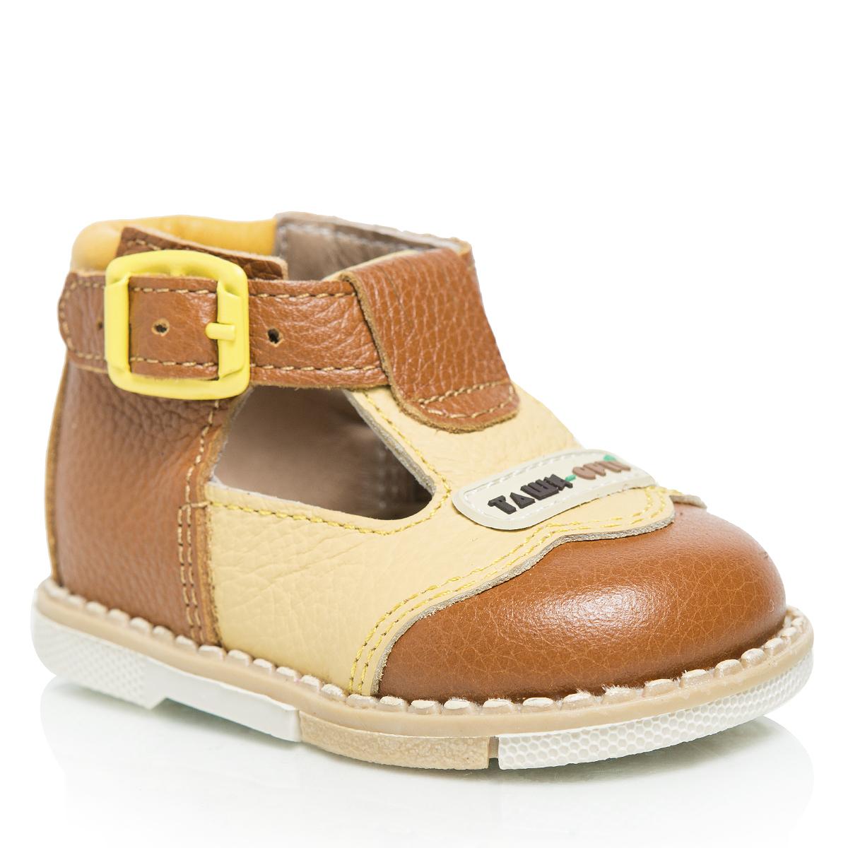 Туфли детские. 112112-09Стильные детские туфли Таши Орто заинтересуют вашего ребенка с первого взгляда. Модель выполнена из натуральной кожи контрастных цветов. Ремешок на застежке-пряжке помогает оптимально подогнать полноту обуви по ноге и гарантирует надежную фиксацию. Подъем декорирован нашивкой с символикой бренда. Литая анатомическая стелька из натуральной кожи со сводоподдерживающим элементом и латексным покрытием, не продавливающаяся во время носки, обеспечивает правильное формирование стопы. Благодаря использованию современных внутренних материалов, позволяет оптимально распределить нагрузку по всей площади стопы, дает ножке ощущение мягкости и комфорта. Мягкая верхняя часть, которая плотно прилегает к ножке, и подкладка, изготовленная из натуральной кожи, позволяют избежать натирания. Полужесткий задник фиксирует ножку ребенка, не давая ей смещаться из стороны в сторону и назад. Широкий, устойчивый каблук, специальной конфигурации каблук Томаса, продлен с внутренней стороны до середины стопы,...