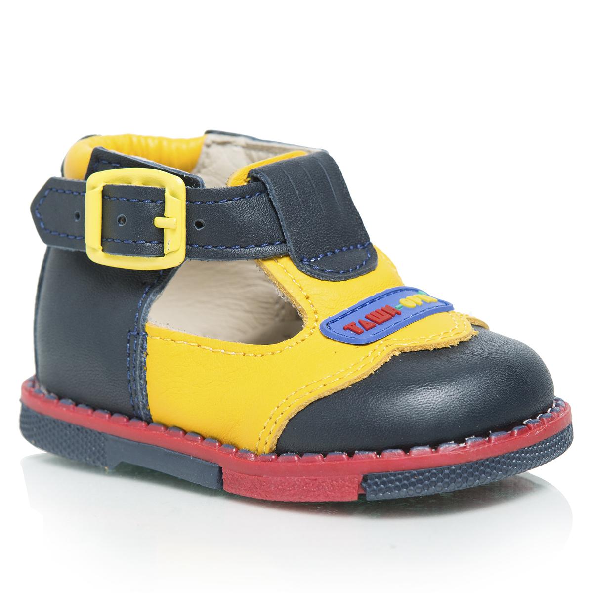 Туфли детские. 112-02112-02Стильные детские туфли Таши Орто заинтересуют вашего ребенка с первого взгляда. Модель выполнена из натуральной кожи контрастных цветов. Ремешок на застежке-пряжке помогает оптимально подогнать полноту обуви по ноге и гарантирует надежную фиксацию. Подъем декорирован нашивкой с символикой бренда. Литая анатомическая стелька из натуральной кожи со сводоподдерживающим элементом и латексным покрытием, не продавливающаяся во время носки, обеспечивает правильное формирование стопы. Благодаря использованию современных внутренних материалов, позволяет оптимально распределить нагрузку по всей площади стопы, дает ножке ощущение мягкости и комфорта. Мягкая верхняя часть, которая плотно прилегает к ножке, и подкладка, изготовленная из натуральной кожи, позволяют избежать натирания. Полужесткий задник фиксирует ножку ребенка, не давая ей смещаться из стороны в сторону и назад. Широкий, устойчивый каблук, специальной конфигурации каблук Томаса, продлен с внутренней стороны до середины стопы,...