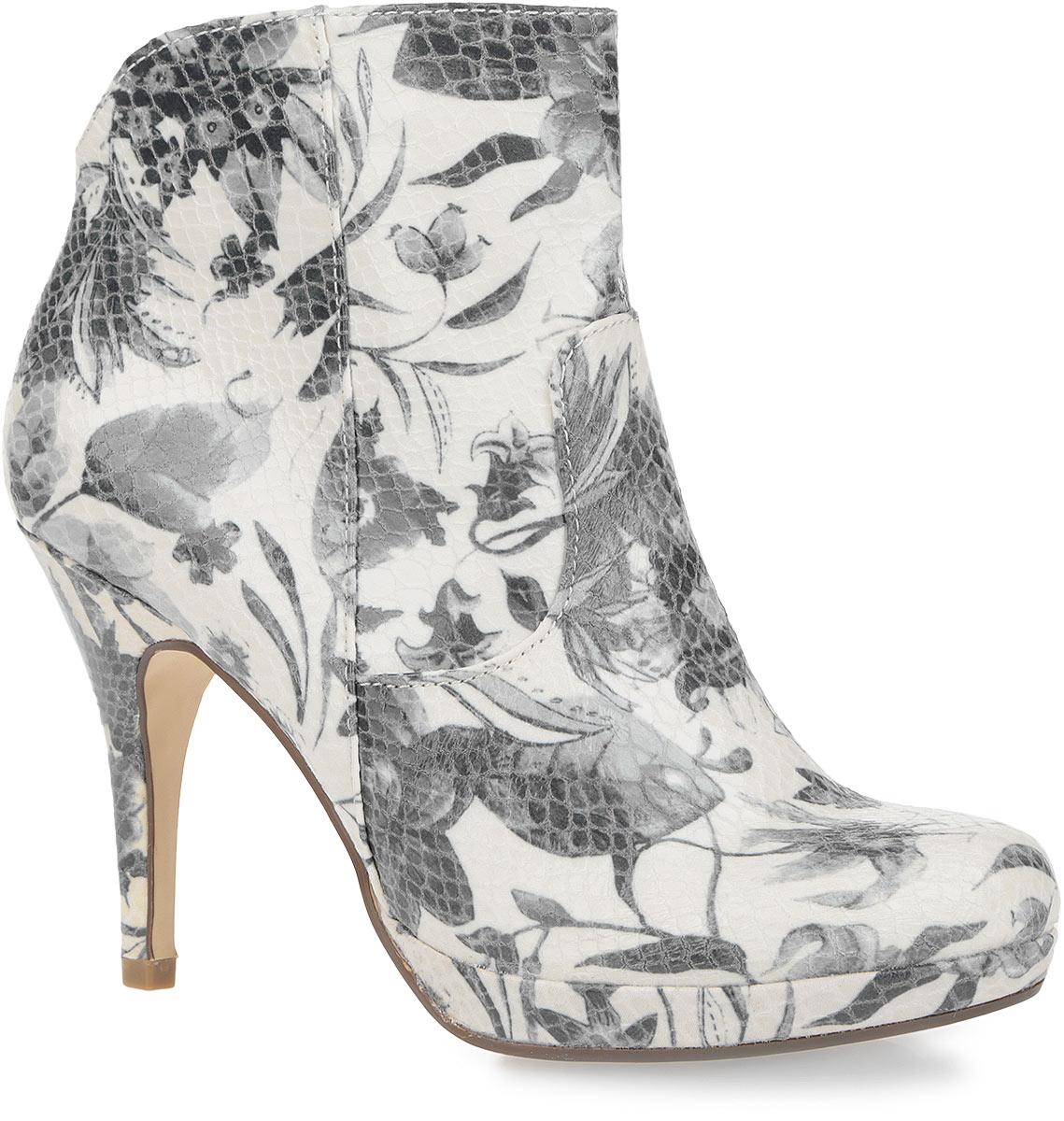 1-1-25348-36-160Восхитительные ботильоны от Tamaris покорят вас с первого взгляда. Модель выполнена из текстиля с глянцевой поверхностью, оформленного цветочным принтом и узором в виде тиснения под рептилию. Закругленный носок добавит женственности в ваш образ. Внутренняя часть обуви и стелька, изготовлены из мягкого текстиля, который обеспечивает ногам комфорт и уют. Изделие застегивается на замок-молнию, расположенную на одной из боковых сторон. Задник дополнен фигурным вырезом. Высокий каблук компенсирован платформой. Подошва с рельефным протектором не скользит. Модные ботильоны займут достойное место среди вашей коллекции обуви.