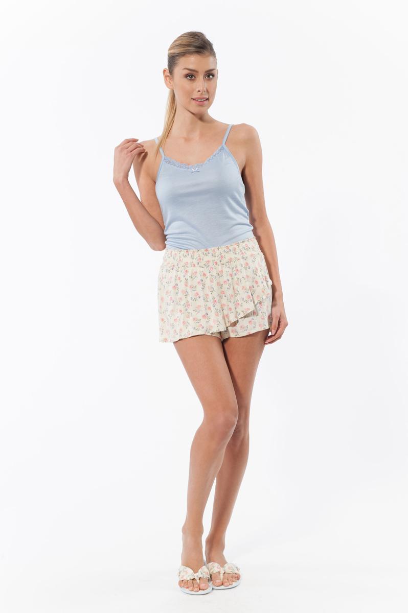 Комплект женский: топ, шорты. 1338913389Комплект женской одежды Relax Mode, состоящий из топа и шорт, станет отличным дополнением к вашему гардеробу. Выполненный из качественной вискозы, комплект мягкий и приятный на ощупь, не сковывает движения и позволяет коже дышать, обеспечивая наибольший комфорт. Стильный топ на тонких бретелях с кружевной оторочкой по краю лифа спереди декорирован небольшим текстильным бантом. Шорты-юбка оформлены нежным цветочным принтом. Модель с широкой эластичной резинкой на поясе дополнена небольшим металлический декоративный элемент в виде цветка. Стильный комплект одежды подарит вам удобство и комфорт, подчеркнет вашу индивидуальность.