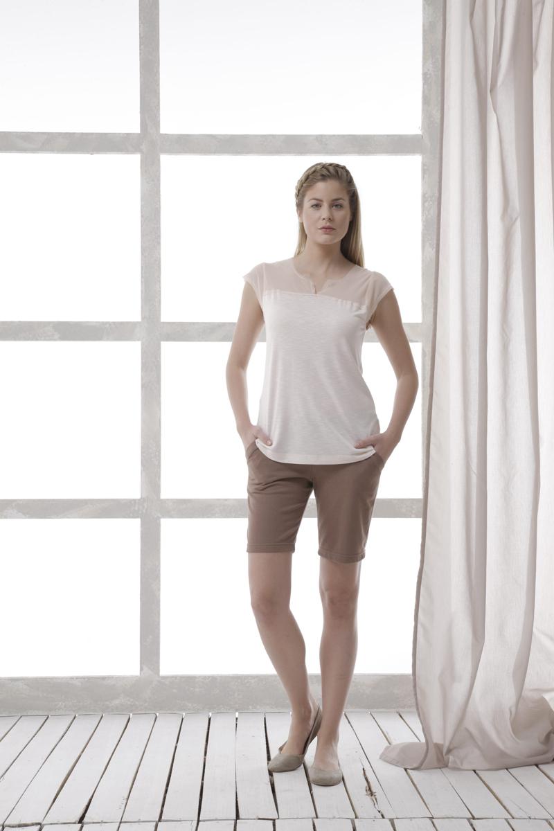 Комплект женский: футболка, шорты. 3542535425Комплект женской одежды Relax Mode, состоящий из футболки и шорт, станет отличным дополнением к вашему гардеробу. Выполненный из качественных материалов, комплект мягкий и приятный на ощупь, не сковывает движения и позволяет коже дышать, обеспечивая наибольший комфорт. Стильная футболка с V-образным вырезом горловины и короткими рукавами в верхней части выполнена из полупрозрачного материала. Удобные шорты с широкой эластичной резинкой в поясе дополнительно завязываются на текстильный шнурок. По бокам изделие дополнено двумя втачными карманами с косыми срезами. Стильный комплект одежды подарит вам удобство и комфорт, подчеркнет вашу индивидуальность.