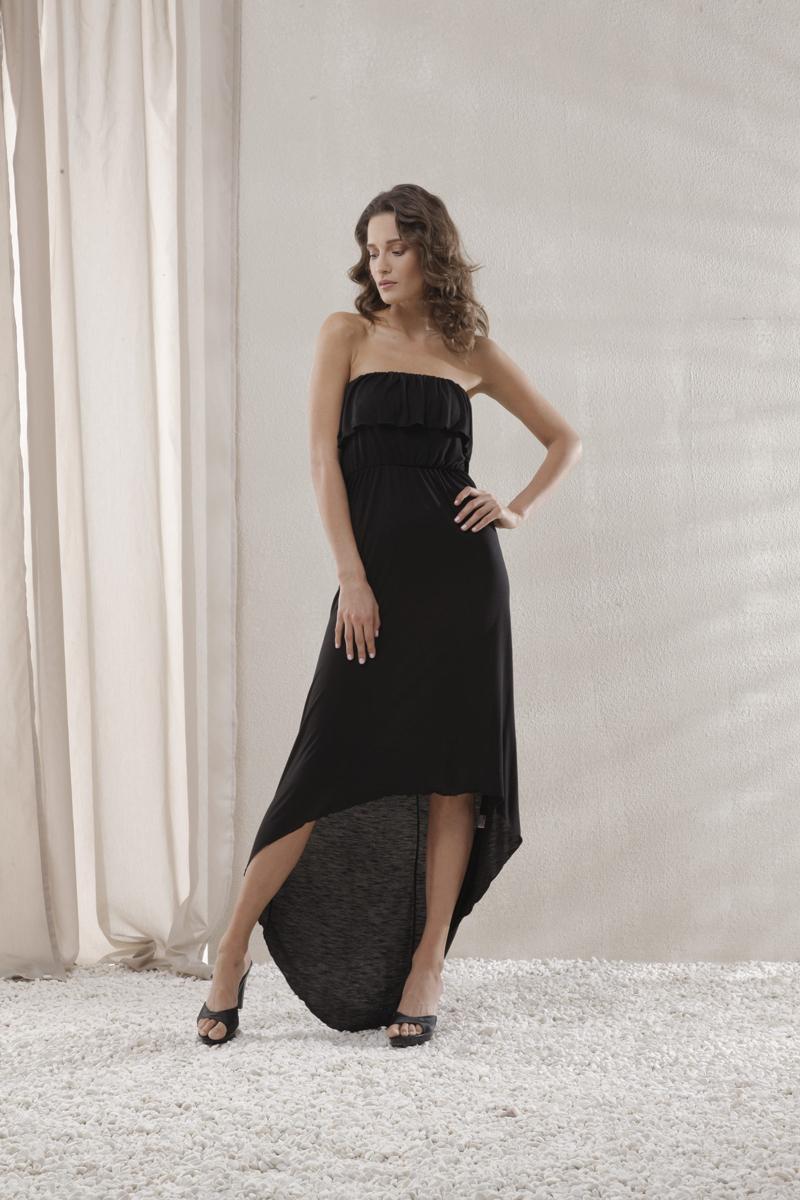 Платье пляжное Holiday. 4607946079Пляжное платье Relax Mode Holiday, выполненное из вискозы, станет отличным дополнением к гардеробу. Материал очень мягкий, приятный на ощупь, не сковывает движений и хорошо вентилируется. Сверху платье оформлено оборкой, придающей изделию оригинальность. На талии модель дополнена тонкой эластичной резинкой. Спинка платья удлинена. Такое платье позволит вам создать неповторимый пляжный образ, в котором вы не останетесь незамеченной!
