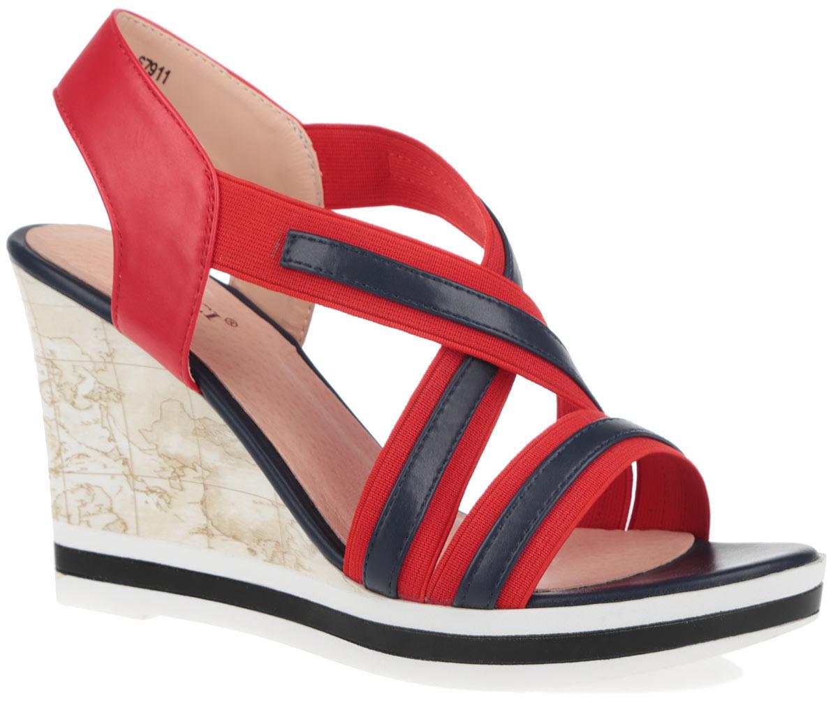 Босоножки. 6791167911Модные босоножки от Vitacci займут достойное место среди вашей коллекции обуви. Модель изготовлена из комбинации искусственной кожи и эластичного текстиля. Верх изделия дополнен нашивками из искусственной кожи контрастного цвета. Эластичные ремешки в области подъема надежно зафиксируют обувь на ноге. Стелька из натуральной кожи комфортна при движении. Высокая танкетка, оформленная оригинальным принтом, дополнена небольшой платформой. Подошва оснащена рифлением для лучшей сцепки с поверхностью. Стильные босоножки - основа гардероба настоящей модницы.