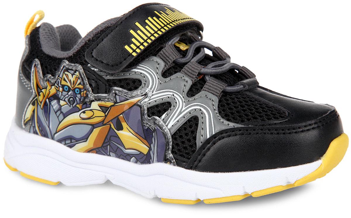 Кроссовки для мальчика Transformers. 5433B5433BСтильные кроссовки Transformers от Kakadu заинтересуют вашего малыша с первого взгляда! Модель выполнена из комбинации синтетической кожи и сетчатого текстиля. Подъем оформлен эластичной шнуровкой и ремешком на застежке-липучке, которые надежно зафиксируют модель на ножке. Благодаря такой застежке ребенок может самостоятельно надевать обувь. Подкладка выполнена из 100% гипоаллергенного хлопка - материала, который позволяет коже дышать и хорошо впитывает влагу. Мягкая анатомическая стелька из EVA-материала с текстильной поверхностью уменьшает усталость ног, нагрузку на суставы и позвоночник, оказывает профилактическое действие против плоскостопия и придает комфорт при ходьбе. Задник дополнен принтом в виде символики бренда и ярлычком для более удобного надевания обуви, ремешок - оригинальным тиснением, язычок - текстильной нашивкой в виде ярлычка. Подошва, изготовленная из EVA-материала и резины, оснащена рифлением для лучшего сцепления с поверхностью. При движении расположенная...