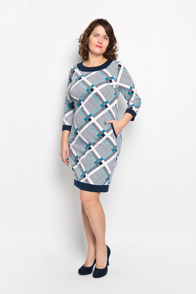 Платье1581Платье Milana Style подчеркнет все достоинства женской фигуры в наиболее выгодном свете. Благодаря составу, в который входит мягкая эластичная вискоза и ПАН, платье приятное на ощупь, не сковывает движений, обеспечивая комфорт. Модель с круглым вырезом горловины и рукавами 3/4 украшена оригинальным принтом. Спереди предусмотрены два втачных кармана. На спинке имеется вставка, декорированная пуговицами. Вырез горловины и карманы оформлены бейкой контрастного цвета. Такое платье станет модным и стильным дополнением к вашему гардеробу!