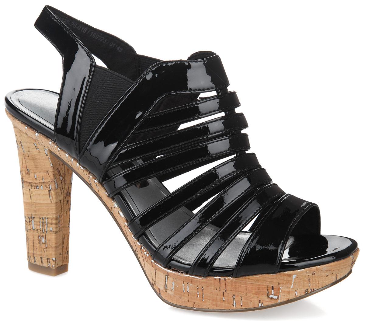 Босоножки. 1-1-28335-26-0181-1-28335-26-018Стильные босоножки от Tamaris займут достойное место в вашем летнем гардеробе. Модель выполнена из искусственной лакированной кожи. Эластичные вставки по бокам обеспечивают идеальную посадку модели на ноге. Стелька из искусственной кожи, дополненная названием бренда, комфортна при ходьбе. Высокий каблук, стилизованный под дерево, компенсирован небольшой платформой. Рифление на подошве и каблуке гарантирует отличное сцепление с любой поверхностью. Модные босоножки внесут яркие нотки в ваш наряд, позволят выделиться среди окружающих.