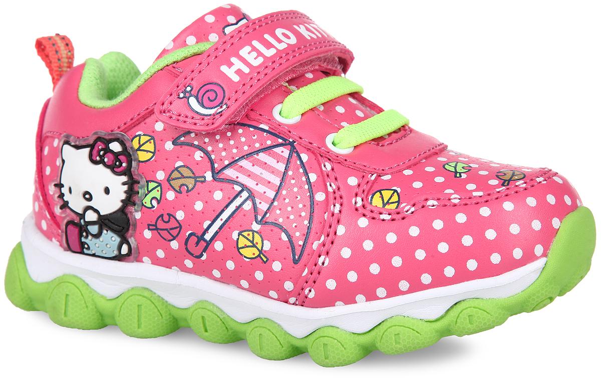 Кроссовки для девочки Hello Kitty. 5295C5295CОригинальные кроссовки Hello Kitty от Kakadu приведут вашу малышку в восторг. Модель выполнена из синтетической кожи, оформленной яркими изображениями и принтом горох. Полужесткий задник и ремешок на застежке-липучке надежно зафиксируют модель на ножке. Благодаря такой застежке ребенок может самостоятельно надевать обувь. Подъем дополнен декоративной эластичной шнуровкой. Подкладка выполнена из 100% гипоаллергенного хлопка - материала, который позволяет коже дышать и хорошо впитывает влагу. Мягкая, амортизирующая, антибактериальная стелька из EVA-материала с текстильной поверхностью обладает высокой воздухопроницаемостью, нейтрализует неприятный запах и препятствует появлению бактерий. Подошва, изготовленная из EVA-материала и термопластичной резины, оснащена рифлением для лучшей сцепки с поверхностью. Задник дополнен ярлычком для более удобного надевания обуви, язычок и ремешок декорированы принтом в виде символики бренда. При движении расположенная сбоку нашивка с...