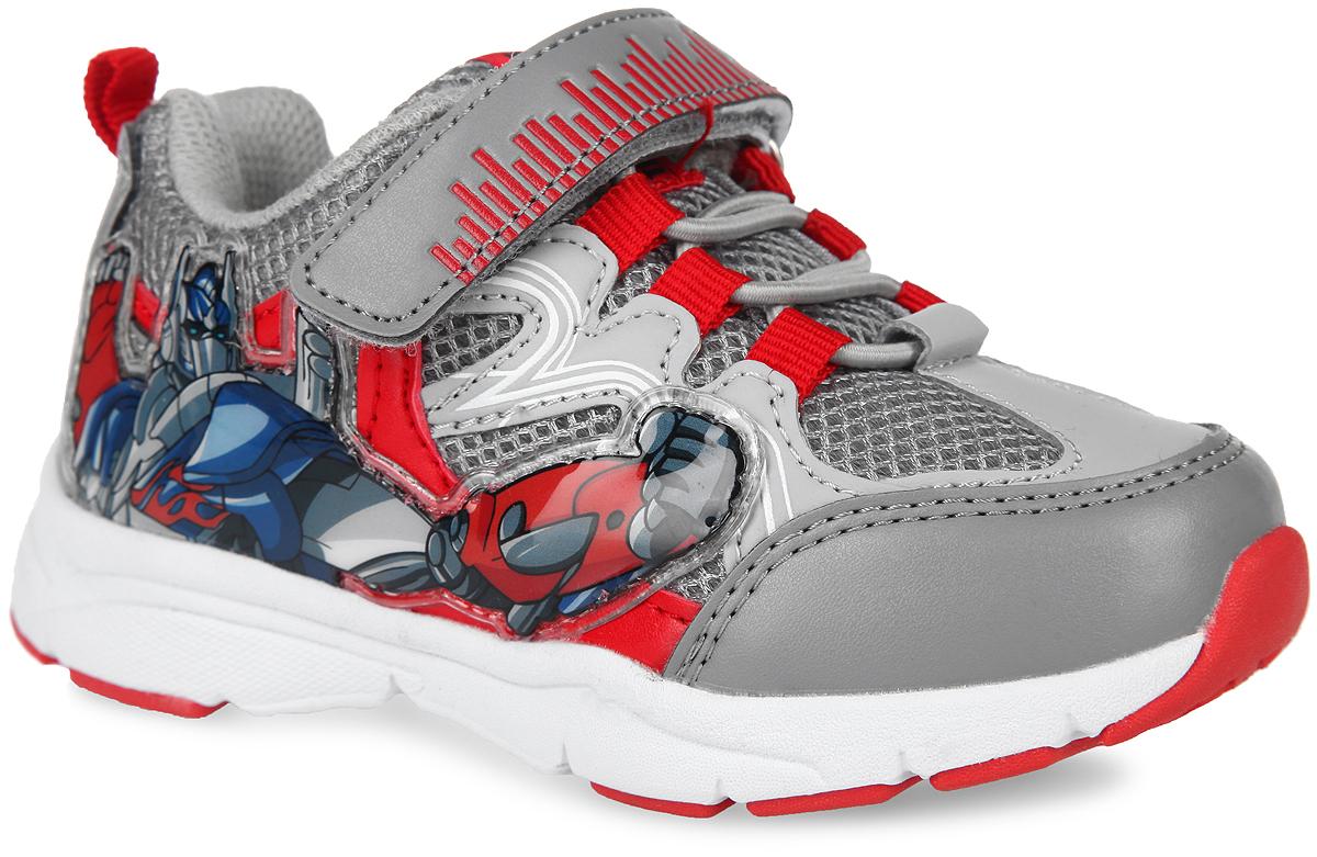Кроссовки для мальчика Transformers. 5433A5433AСтильные кроссовки Transformers от Kakadu заинтересуют вашего малыша с первого взгляда! Модель выполнена из комбинации синтетической кожи и сетчатого текстиля. Подъем оформлен эластичной шнуровкой и ремешком на застежке-липучке, которые надежно зафиксируют модель на ножке. Благодаря такой застежке ребенок может самостоятельно надевать обувь. Подкладка выполнена из 100% гипоаллергенного хлопка - материала, который позволяет коже дышать и хорошо впитывает влагу. Мягкая анатомическая стелька из EVA-материала с текстильной поверхностью уменьшает усталость ног, нагрузку на суставы и позвоночник, оказывает профилактическое действие против плоскостопия и придает комфорт при ходьбе. Задник дополнен принтом в виде символики бренда и ярлычком для более удобного надевания обуви, ремешок - оригинальным тиснением, язычок - текстильной нашивкой в виде ярлычка. Подошва, изготовленная из EVA-материала и резины, оснащена рифлением для лучшей сцепки с поверхностью. При движении расположенная...