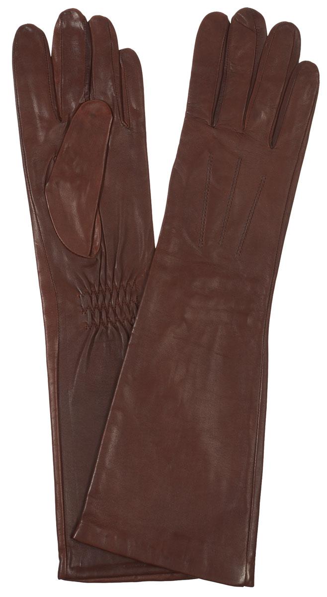 IS598Элегантные удлиненные женские перчатки Eleganzza станут великолепным дополнением вашего образа и защитят ваши руки от холода и ветра во время прогулок. Перчатки выполнены из натуральной кожи ягненка. На внешней стороне - шов 3 луча. Тыльная сторона дополнена резинкой для оптимальной посадки модели на руке. Такие перчатки будут оригинальным завершающим штрихом в создании современного модного образа, они подчеркнут ваш изысканный вкус и станут незаменимым и практичным аксессуаром.