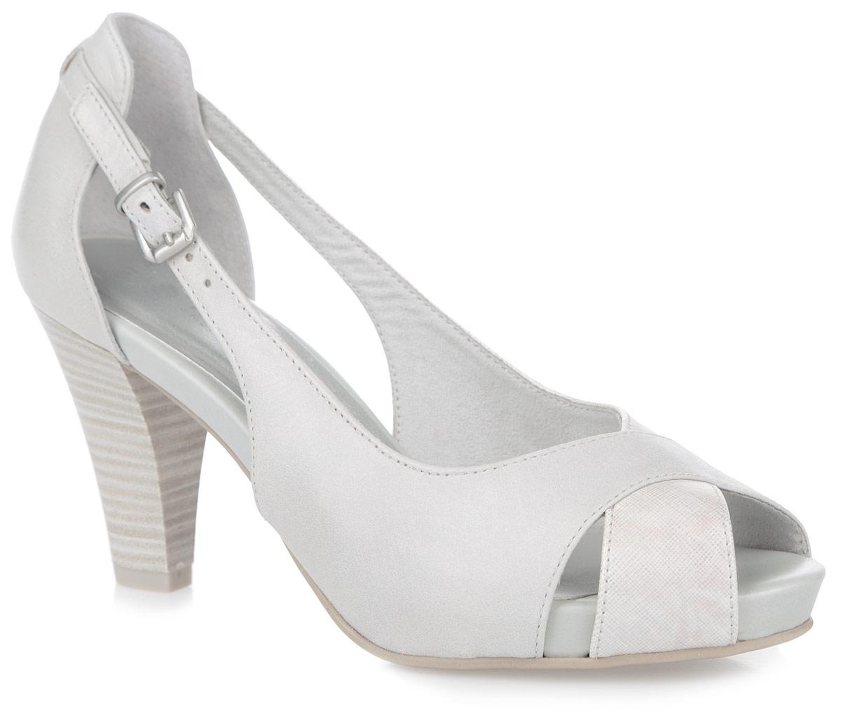 2-2-29300-26-213Потрясающие туфли от Marco Tozzi не оставят равнодушной настоящую модницу! Модель выполнена из натуральной и искусственной кожи. Ремешок с металлической пряжкой, дополненный резинкой, отвечает за надежную фиксацию изделия на ноге. Длина ремешка регулируется за счет болта. Открытый носок смотрится невероятно женственно. Стелька из искусственной кожи гарантирует комфорт при ходьбе. Высокий каблук-столбик, стилизованный под дерево, компенсирован платформой. Подошва с рифлением обеспечивает идеальное сцепление с любыми поверхностями. Элегантные туфли внесут изысканные нотки в ваш образ и подчеркнут вашу утонченную натуру.