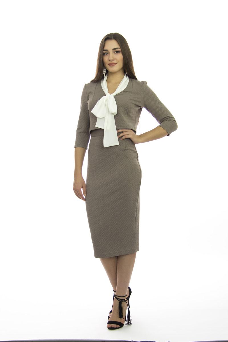 Комплект: жакет, юбка. к511к511Модный костюм, состоящий укороченного жакета и юбки, выполненных из трикотаж-жаккарда однотонной расцветки. V образный вырез горловины. Втачные рукава 3/4. Юбка средней длины. Высокая посадка. Сзади застежка-молния. Отличный выбор для офиса.