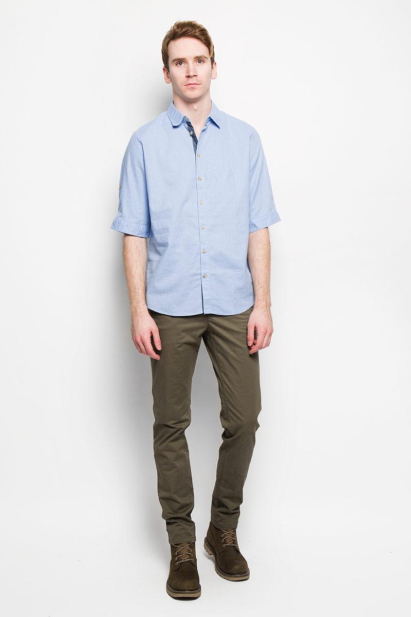 Hs-212/670-6123Стильная мужская рубашка Sela, выполненная из хлопка и льна, мягкая и приятная на ощупь, не сковывает движения и позволяет коже дышать, обеспечивая комфорт. Модель с отложным воротником и короткими рукавами застегивается на пластиковые пуговицы по всей длине. Низ рукава обработан манжетами, которые застегиваются на пуговицы. Эта модная и удобная рубашка послужит отличным дополнением к вашему гардеробу.