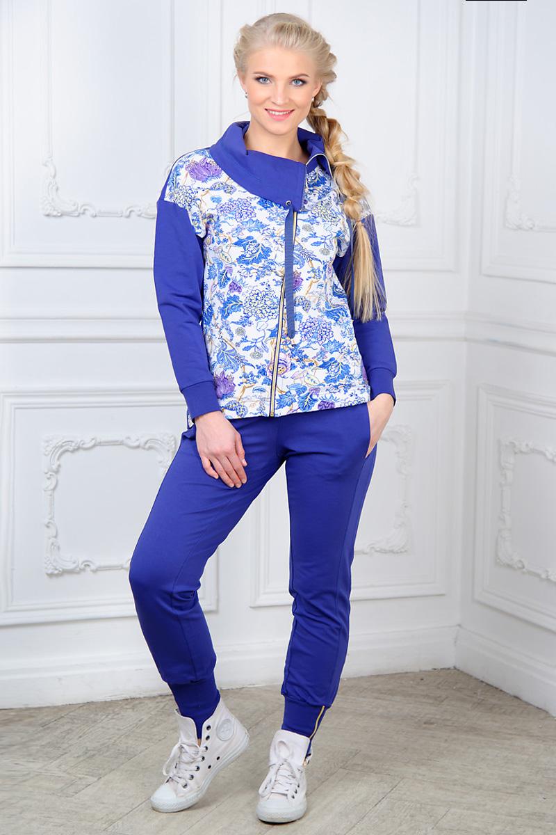 Домашний комплектAW15-UAT-LST-286Женский домашний костюм Santi состоит из толстовки и брюк. Костюм выполнен из эластичного хлопка. Толстовка с воротником-гольф, дополненным шнурком, и длинными рукавами застегивается на ассиметричную застежку-молнию. Спереди толстовка оформлена цветочным принтом. Манжеты рукавов дополнены трикотажными резинками. Брюки с широким эластичным поясом оснащены по бокам втачными карманами. Нижняя часть брюк дополнена широкими трикотажными резинками с застежками-молниями.