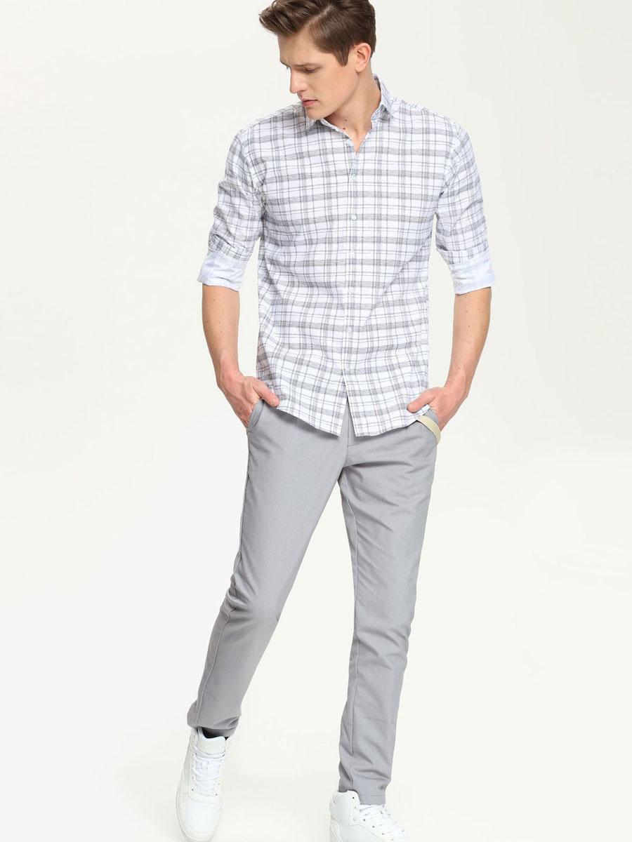 Рубашка мужская. SKD0136BISKD0136BIСтильная мужская рубашка Top Secret, выполненная из натурального хлопка, обладает высокой теплопроводностью, воздухопроницаемостью и гигроскопичностью, позволяет коже дышать, тем самым обеспечивая наибольший комфорт при носке. Модель приталенного кроя с отложным воротником застегивается на пуговицы. Длинные рукава рубашки дополнены манжетами на пуговицах. Оформлено изделие геометрическим принтом. Такая рубашка подчеркнет ваш вкус и поможет создать великолепный стильный образ.