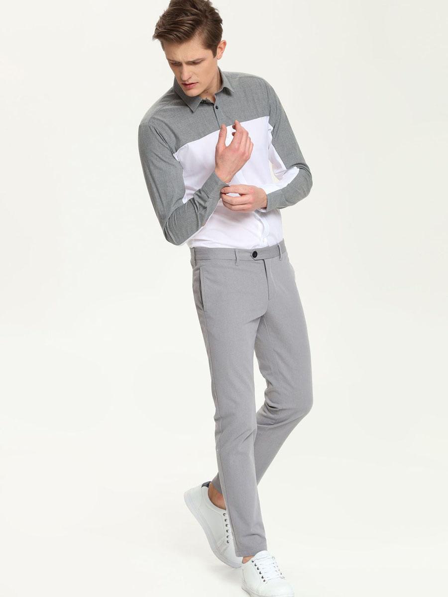 РубашкаSKL1963BIСтильная мужская рубашка Top Secret, выполненная из натурального хлопка, обладает высокой теплопроводностью, воздухопроницаемостью и гигроскопичностью, позволяет коже дышать, тем самым обеспечивая наибольший комфорт при носке. Модель приталенного кроя с отложным воротником застегивается на пуговицы. Длинные рукава рубашки дополнены манжетами на пуговицах. Верх изделия выполнен в контрастном цвете. Такая рубашка подчеркнет ваш вкус и поможет создать великолепный стильный образ.