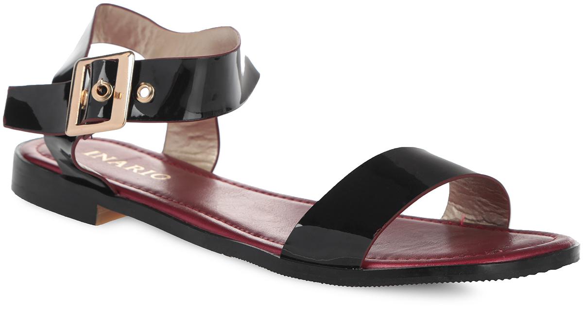 Сандалии женские. 1128-02-11128-02-1Стильные сандалии от Inario не оставят вас равнодушной! Модель изготовлена из искусственной лакированной кожи. Стелька из искусственной кожи, оформленная названием бренда, комфортна при движении. Ремешок с металлической пряжкой позволит прочно зафиксировать обувь на вашей ножке. Небольшой каблук и подошва с рифлением обеспечивают идеальное сцепление с любой поверхностью. Стильные сандалии помогут вам создать неповторимый образ.