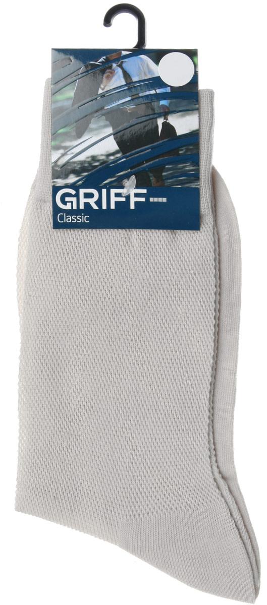 Носки мужские Classic. B35B35Мужские носки Griff Classic изготовлены из высококачественного сырья с добавлением полиамидных и эластичных волокон, которые обеспечивают великолепную посадку. Носки отличаются элегантным внешним видом. Удобная широкая резинка идеально облегает ногу и не пережимает сосуды, усиленные пятка и мысок повышают износоустойчивость носка, а удлиненный паголенок придает более эстетичный вид.