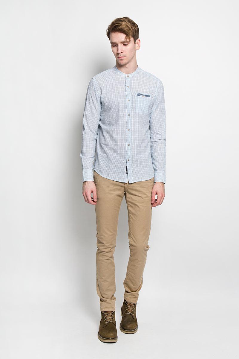 Рубашка20100147 547Стильная мужская рубашка Broadway, изготовленная из высококачественного фактурного хлопка, необычайно мягкая и приятная на ощупь, не сковывает движения и позволяет коже дышать, обеспечивая наибольший комфорт. Модная рубашка с круглым вырезом горловины, длинными рукавами и полукруглым низом застегивается на пластиковые пуговицы. Модель оформлена принтом в мелкую полоску и на груди слева дополнена прорезным кармашком на пуговице. Рукава рубашки дополнены манжетами на пуговицах. Эта рубашка идеальный вариант для повседневного гардероба. Такая модель порадует настоящих ценителей комфорта и практичности!