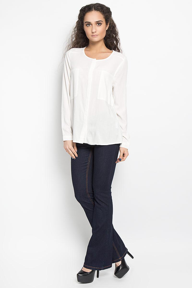 10156086_001Стильная женская блуза Broadway Berkeley, выполненная из вискозы, подчеркнет ваш уникальный стиль и поможет создать оригинальный женственный образ. Блузка с круглым вырезом горловины и длинными рукавами застегивается на скрытые пуговицы спереди, манжеты рукавов также дополнены пуговицами. Модель идеально подойдет для летних дней. Такая блузка будет дарить вам комфорт в течение всего дня и послужит замечательным дополнением к вашему гардеробу.