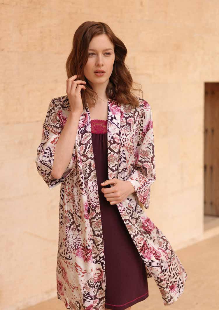 Платье717631Элегантное платье Penye Mood, выполненное из высококачественного материала, будет отлично на вас смотреться. Модель приталенного силуэта с длинными рукавами и V-образным вырезом горловины расширена к низу. Изюминка платья - кружевной принт и дополняющая его гипюровая вставка в области горловины. Это стильное платье подарит вам комфорт и станет отличным дополнением к вашему гардеробу.