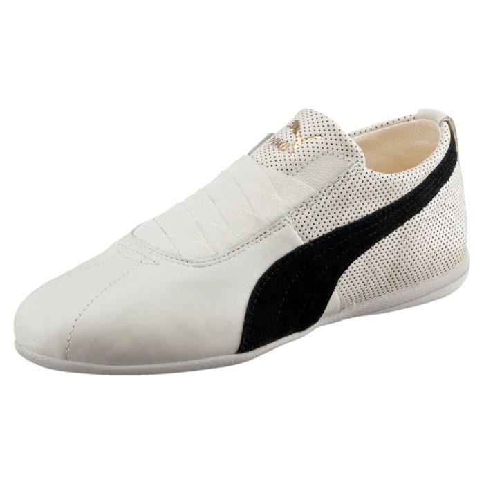 Кроссовки женские Eskiva Low Wn s. 3610090236100902Еще в 60-х годах прошлого века PUMA создала боксерки Gong, которые носил даже чемпион Олимпийских Игр в Мюнхене в 1972 году. Сегодня линия Gong нашла своё новое и неожиданное продолжение в модной коллекции женской обуви Eskiva, где традиции органично объединяются с интересными дизайнерскими находками. Модель Eskiva Low имеет элегантный низкий силуэт, верх из мягкой натуральной кожи и изящные застежки из эластичной тесьмы, но при этом снабжены броскими деталями, развивающими боксерскую тему.