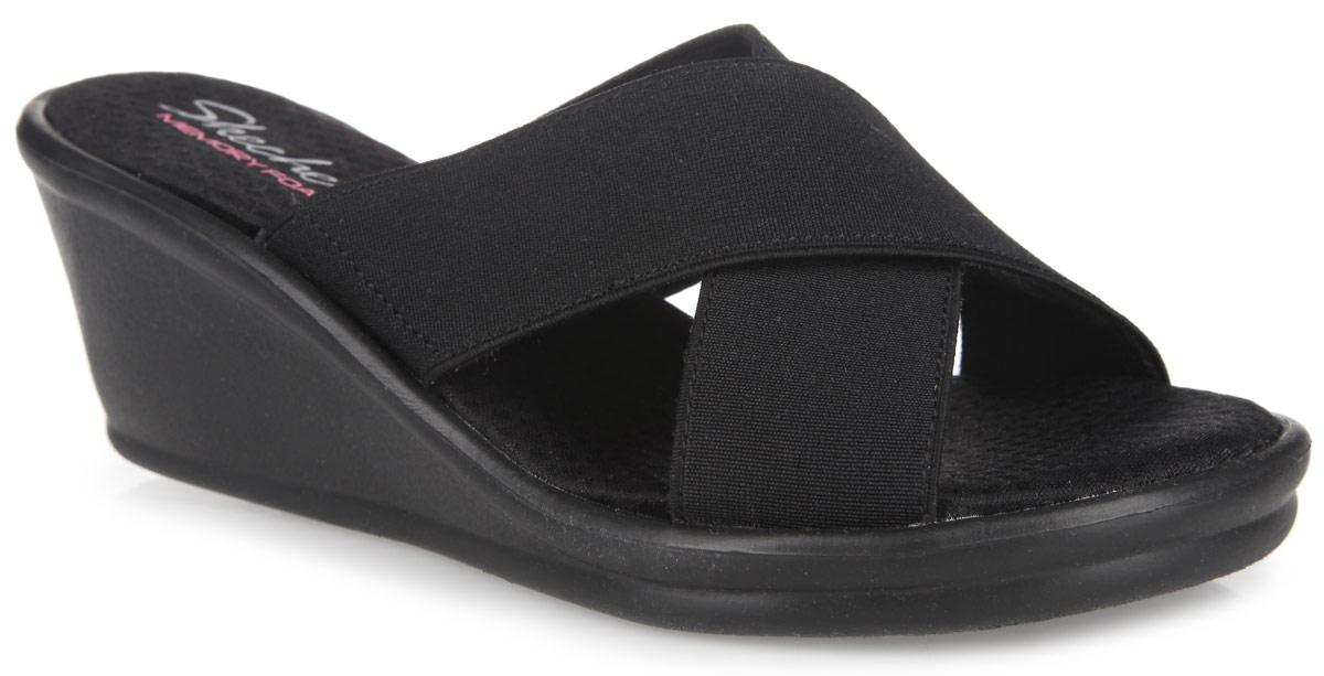 Сабо женские Rumblers-Gore-Geous. 38473-BLK38473-BLKЖенские сабо от Skechers Rumblers-Gore-Geous отлично подойдут как для пляжа, так и для повседневного использования. Верх обуви выполнен в виде двух перекрещенных полосок из эластичного текстильного материала, которые позволяют фиксировать обувь на ноге. Текстильные подкладка и стелька предотвратят натирание. Стелька с супинатором и технологией Memory Foam обладает эффектом памяти - быстро возвращается в исходную форму после деформации и повторяет контур стопы. Невысокая танкетка удобна. Подошва оснащена рифлением для лучшего сцепления с поверхностями. Такие сабо придутся вам по душе.