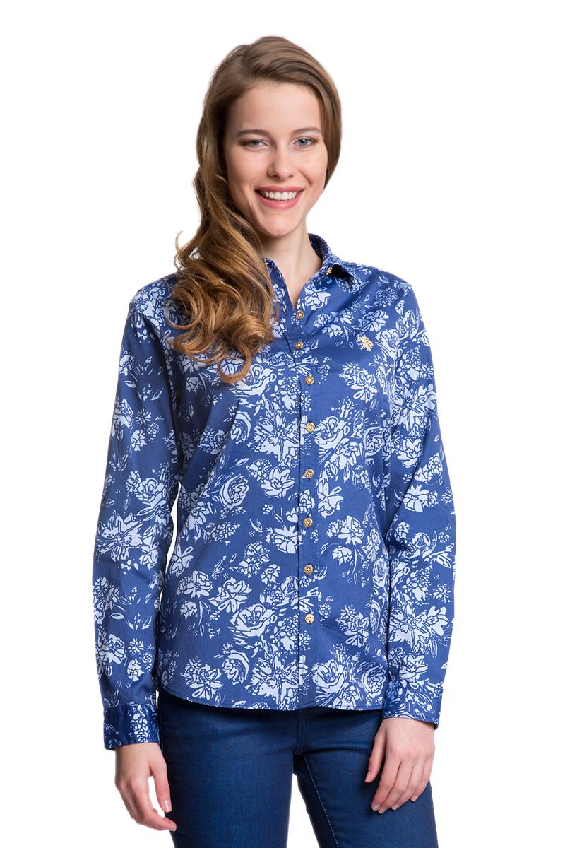 G082SZ004HELGAFLOX_VR013Женская рубашка U.S. Polo Assn. выполнена из натурального хлопка. Модель с отложным воротником и длинными рукавами застегивается спереди на пуговицы по всей длине. На манжетах предусмотрены застежки-пуговицы. Рубашка украшена вышитым логотипом бренда.