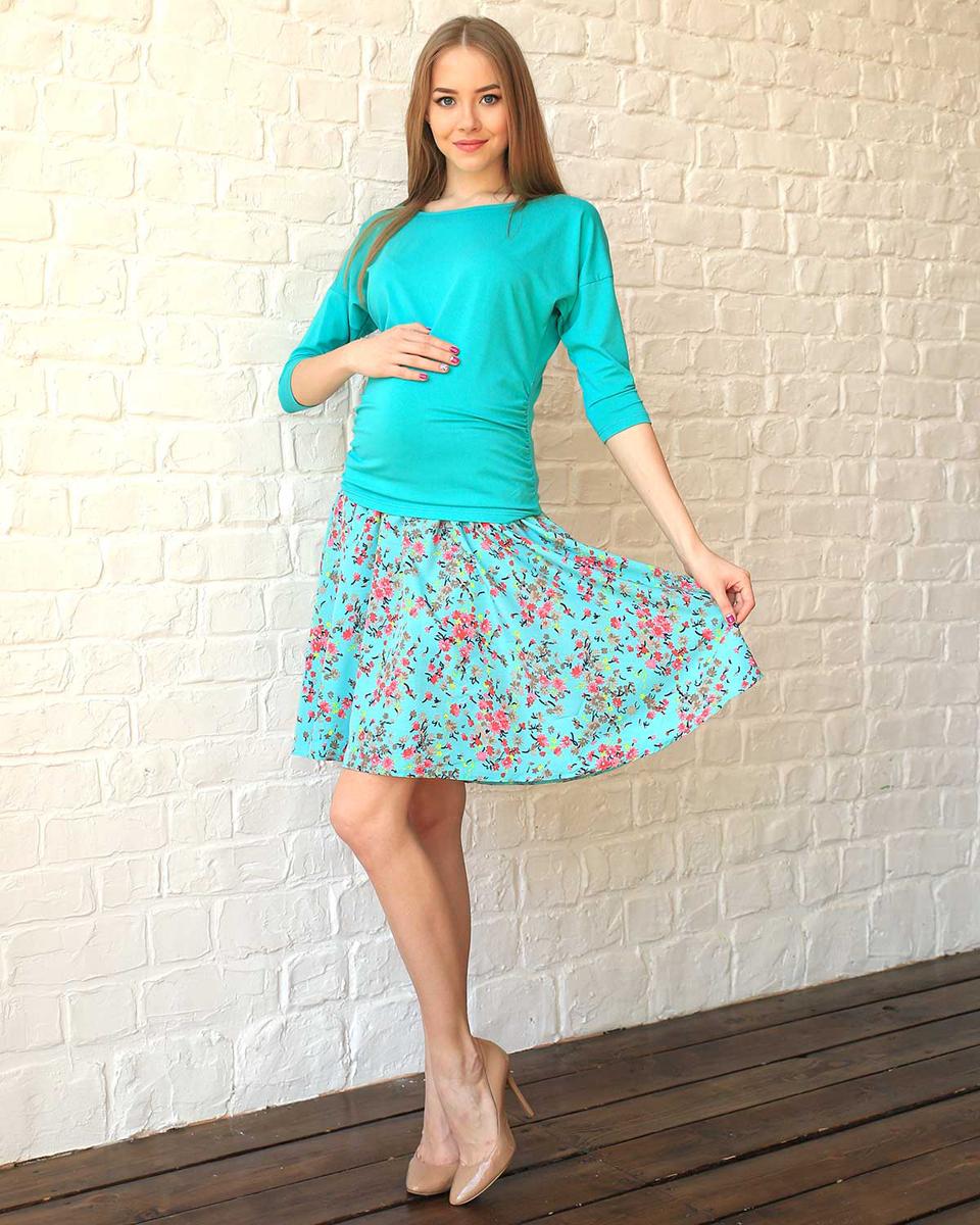 93501Яркая юбка с цветочным принтом будет незаменима в жаркую летнюю погоду. Эластичная вставка обеспечит комфорт растущему животику. Фэст — одежда по вашей фигуре.