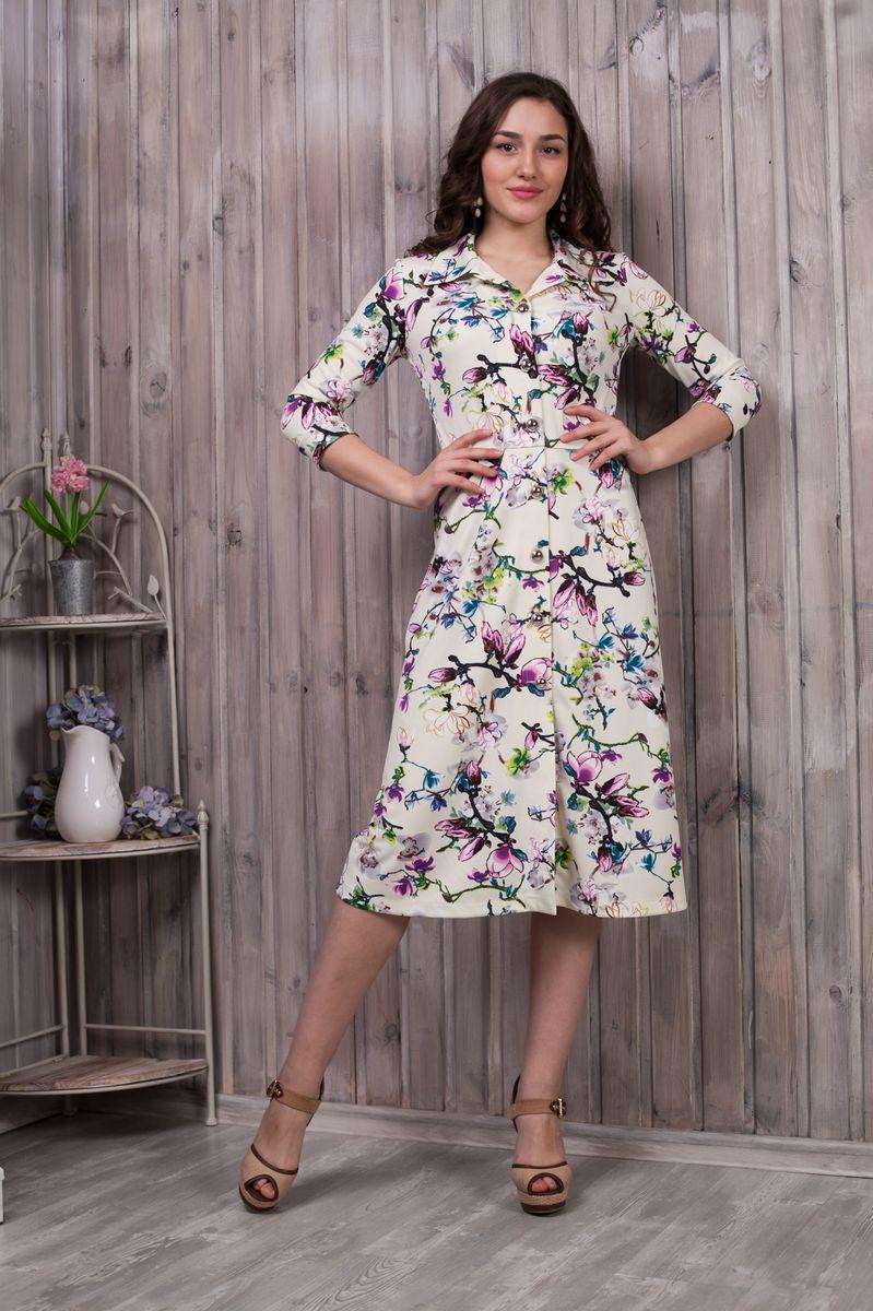 Платье781Элегантное платье Lautus выполнено из высококачественного эластичного полиэстера с добавлением вискозы. Оно обеспечит вам комфорт и удобство при носке. Модель с рукавами 3/4 и отложным воротником выгодно подчеркнет все достоинства вашей фигуры, благодаря приталенному силуэту. Изделие оформлено модным цветочным принтом. Платье-миди застегивается на объемные пластиковые пуговицы спереди по всей длине изделия. Рукава дополнены манжетами. Изысканная модель создаст обворожительный и неповторимый образ. Это модное и удобное платье станет превосходным дополнением к вашему гардеробу, оно подарит вам удобство и поможет вам подчеркнуть свой вкус и неповторимый стиль.