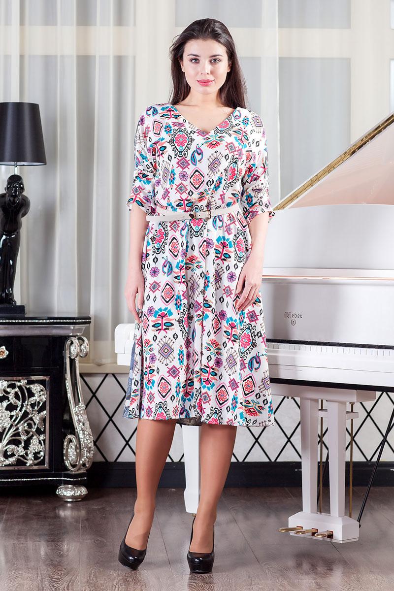 111241_01Стильное платье с карманами в боковых швах из лёгкой ткани с цветочным принтом мгновенно создаст летнее настроение! Модель свободного кроя с V-образным вырезом горловины. Втачной рукав 3/4 со спущенным плечом декорирован складками.