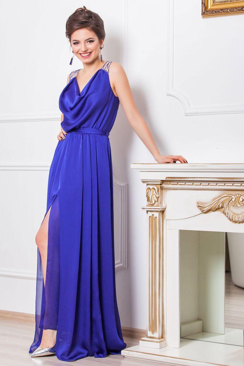 Платье4640_102Очаровательное вечернее платье Seam, выполненное из высококачественного полиэстера, оно отлично сидит по фигуре и подчеркнет ваши достоинства. Платье-макси с воротником-качели не имеет рукавов и застежек. Сзади по спинке модель выполнена легкой тканью с вышивкой лепестков и прорезями. Сбоку платье дополнено большим разрезом и в поясе оформлено шлевками и небольшим пояском.
