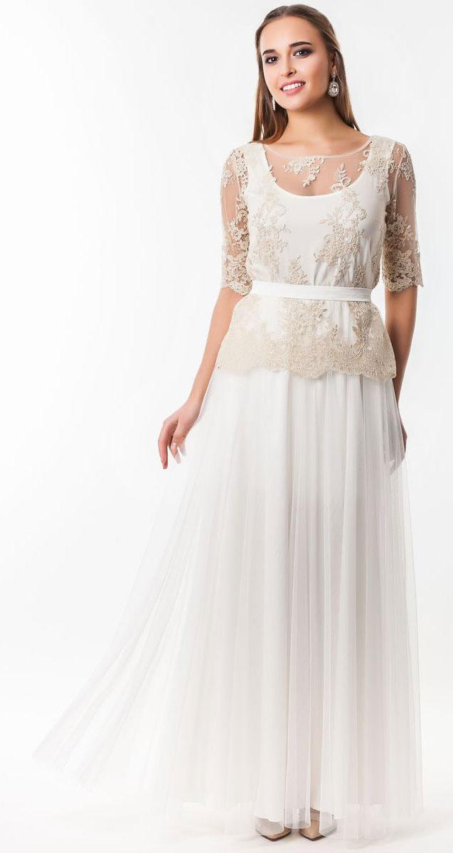 4810_201Очаровательное вечернее платье Seam, выполненное из высококачественного полиэстера, оно отлично сидит по фигуре и подчеркнет ваши достоинства. Платье-макси состоит из юбки, удлиненной майки и накладной блузы. В поясе юбка на эластичной резинке, а верх выполнен из пышной сетчатой ткани. Удлиненная майка служит подкладкой в данной модели. Накладная блуза надевается сверху и застегивается по спинке на пуговицы. Оформлена блуза элегантной вышивкой из нитей с люрексом.