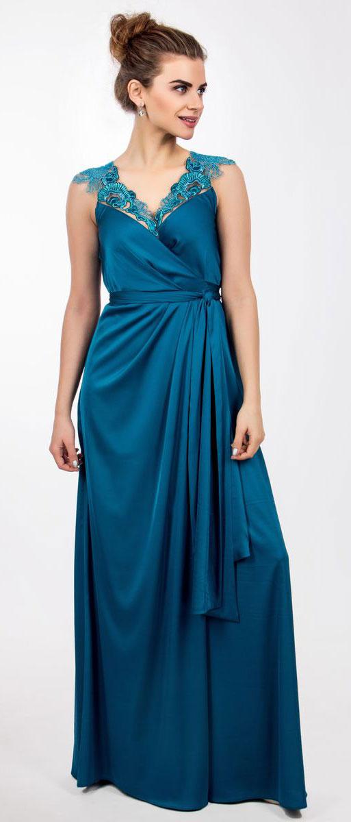 4440_102Стильное платье Seam выполнено из полиэстера с добавлением спандекса. Двойное платье-макси с запахом по талии дополнено поясом которым можно завязать оригинальным бантом спереди или сзади. Лиф модели дополнен вставками из сетчатого материала и оформлен вышитыми цветами расшитыми бисером.