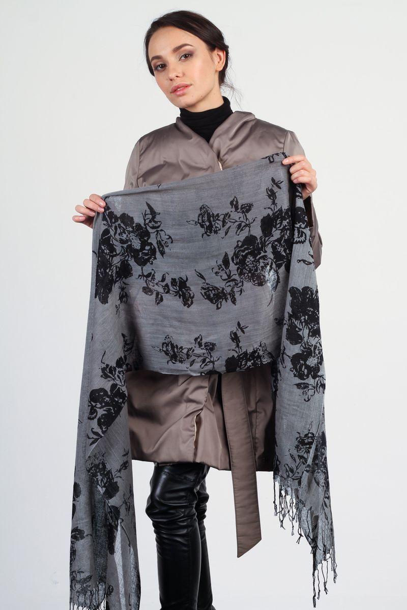 OVS-11VP187-2Стильный женский палантин Laura Milano станет великолепным завершением любого наряда. Палантин изготовлен из вискозы и льна, и оформлен цветочным принтом. По краям модель дополнена кистями бахромы. Изящный палантин поможет вам создать изысканный женственный образ, а также согреет в непогоду.
