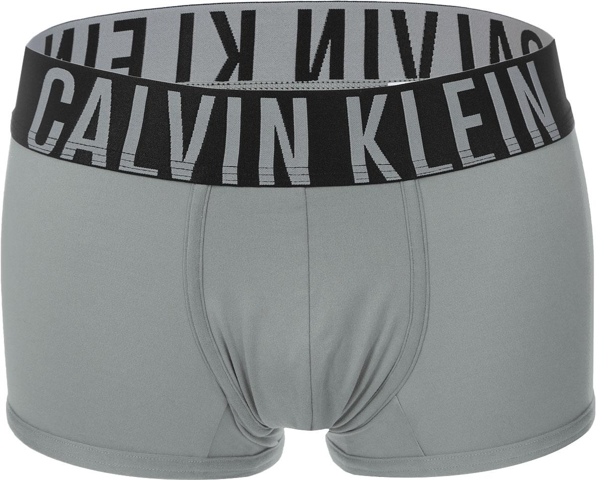 Трусы-боксеры мужские. NB1047ANB1047A_74CТрусы-боксеры Calvin Klein выполнены из полиэстера и эластана. Низкая посадка и широкая резинка на талии обеспечат наибольший комфорт. Резинка оформлена вышивкой с названием бренда. Швы мягкие, эластичные. Модель создана для тех, кто предпочитает комфорт, практичность и современный дизайн.