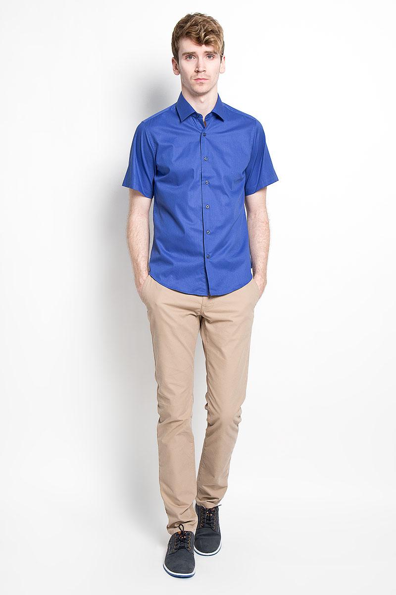 РубашкаSW 83_01Мужская рубашка KarFlorens, изготовленная из высококачественного хлопка с добавлением микрофибры, необычайно мягкая и приятная на ощупь, она не сковывает движения и позволяет коже дышать, обеспечивая комфорт. Модель приталенного кроя с короткими рукавами и отложным воротником застегивается на пластиковые пуговицы, которые декорированы названием бренда. Такая рубашка станет идеальным вариантом для повседневного гардероба. Она порадует настоящих ценителей комфорта и практичности!