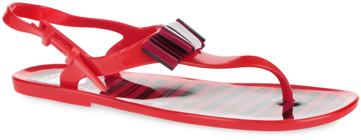 25869A_BLACK-WHITEПрелестные женские сандалии от Mon Ami покорят вас с первого взгляда. Модель полностью выполнена из ПВХ и украшена в области подъема стильным бантом. Ремешок с перемычкой и пяточный ремешок с фиксатором гарантируют надежную фиксацию изделия на ноге. Верхняя поверхность подошвы и декоративный элемент оформлены оригинальным принтом в полоску. Рельефное основание подошвы обеспечивает уверенное сцепление с любой поверхностью. Удобные сланцы прекрасно подойдут для похода в бассейн или на пляж.