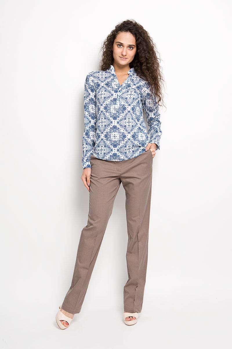 БлузкаS16-32021Стильная женская блуза Finn Flare, выполненная из 100% вискозы, подчеркнет ваш уникальный стиль и поможет создать оригинальный женственный образ. Блузка с длинными рукавами и V-образным вырезом горловины оформлена изысканным этническим орнаментом и дополнена небольшим металлическим лейблом с логотипом производителя на спинке. Модель застегивается на пуговицы на груди, манжеты рукавов также дополнены пуговицами. Такая блузка идеально подойдет для жарких летних дней. Такая блузка будет дарить вам комфорт в течение всего дня и послужит замечательным дополнением к вашему гардеробу.