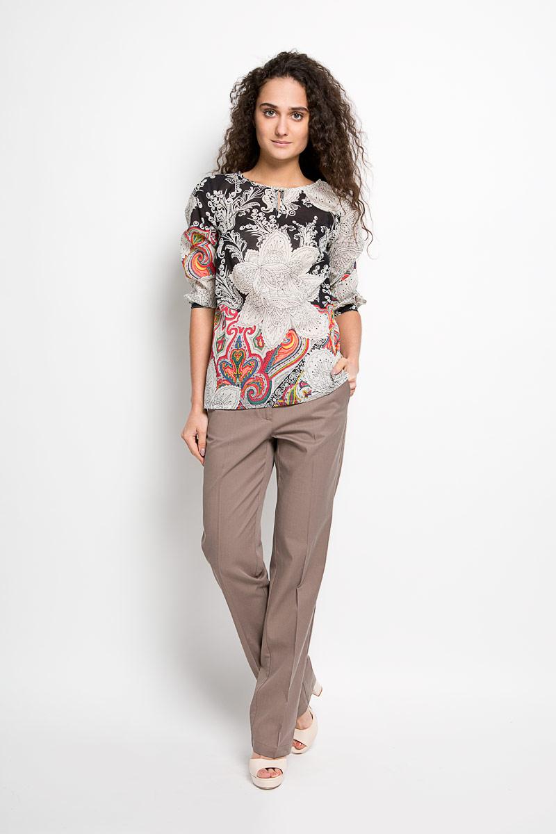 БлузкаS16-12042Стильная женская блуза Finn Flare, выполненная из вискозы с добавлением хлопка, подчеркнет ваш уникальный стиль и поможет создать оригинальный женственный образ. Удлиненная блузка с рукавами 3/4 и круглым вырезом горловины оформлена оригинальным этническим орнаментом. Модель застегивается на пуговицу спереди, манжеты рукавов также дополнены пуговицами. Такая блузка идеально подойдет для жарких летних дней. Такая блузка будет дарить вам комфорт в течение всего дня и послужит замечательным дополнением к вашему гардеробу.