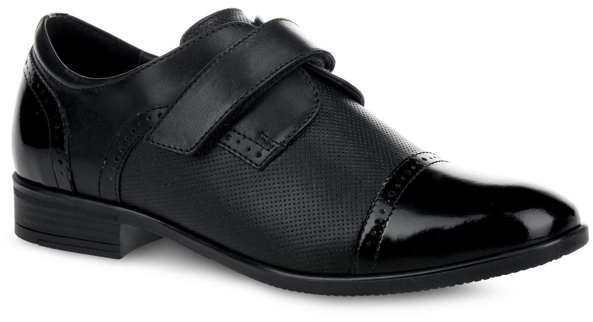 5-518121502Стильные туфли от Elegami придутся по душе вашему юному моднику! Модель выполнена из натуральной кожи разной фактуры и оформлена по верху оригинальной перфорацией. Подкладка, изготовленная из натуральной кожи, предотвратит натирание и гарантирует уют. Стелька из ЭВА материала с верхним покрытием из натуральной кожи дополнена супинатором, который обеспечивает правильное положение ноги ребенка при ходьбе, предотвращает плоскостопие. Ремешок на застежке-липучке надежно зафиксирует изделие на ноге. Подошва оснащена рифлением для лучшего сцепления с различными поверхностями. Удобные классические туфли - незаменимая вещь в гардеробе каждого мальчика.