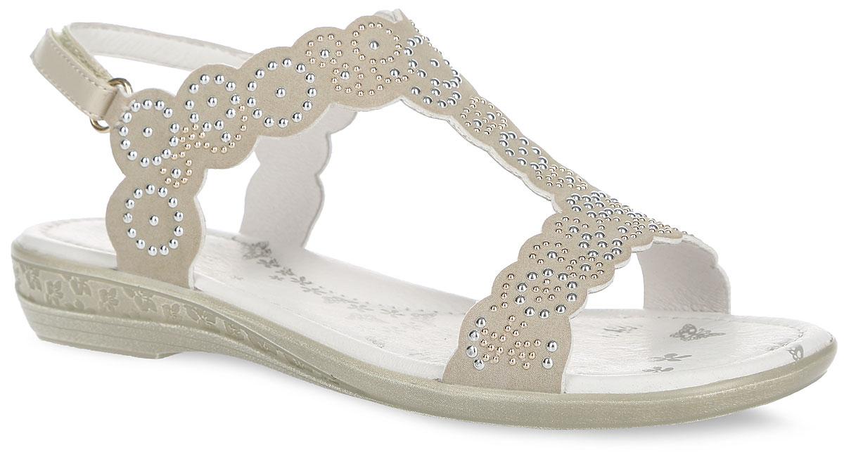Сандалии для девочки. 34041-234041-2Модные сандалии от Kapika придутся по душе вашей девочке и идеально подойдут для повседневной носки в летнюю погоду! Модель изготовлена из искусственной кожи и оформлена металлическими стразами. Ремешок с застежкой-липучкой на пяточной части обеспечивает надежную фиксацию модели на ноге. Внутренняя поверхность и стелька из натуральной кожи комфортны при ходьбе. Стелька оснащена супинатором, который обеспечивает правильное положение стопы ребенка при ходьбе и предотвращает плоскостопие. Подошва с рифлением обеспечивает сцепление с любой поверхностью. Стильные сандалии - незаменимая вещь в гардеробе каждой девочки!