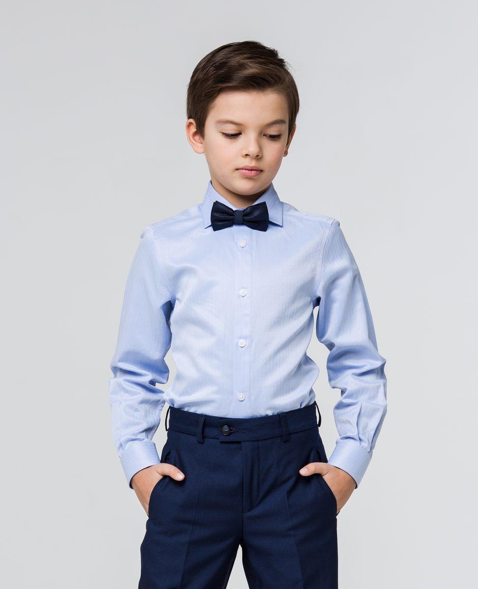 РубашкаSSFSB-629-13831-328Стильная рубашка Silver Spoon станет отличным дополнением к школьному гардеробу вашего мальчика. Модель, выполненная из хлопка с добавлением полиэстера, необычайно мягкая и приятная на ощупь, не сковывает движения и позволяет коже дышать. Рубашка классического кроя с длинными рукавами и отложным воротником застегивается на пуговицы по всей длине. На манжетах предусмотрены застежки-пуговицы.