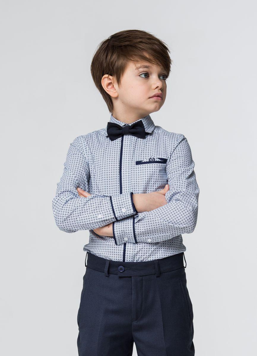SSFSB-629-13834-341Стильная рубашка Silver Spoon станет отличным дополнением к школьному гардеробу вашего мальчика. Модель, выполненная из хлопка с добавлением полиэстера, необычайно мягкая и приятная на ощупь, не сковывает движения и позволяет коже дышать. Рубашка классического кроя с длинными рукавами и отложным воротником застегивается на пуговицы по всей длине. Пуговицы скрыты под планкой. На манжетах предусмотрены застежки-пуговицы. На груди расположен прорезной карман. Модель оформлена оригинальным принтом.