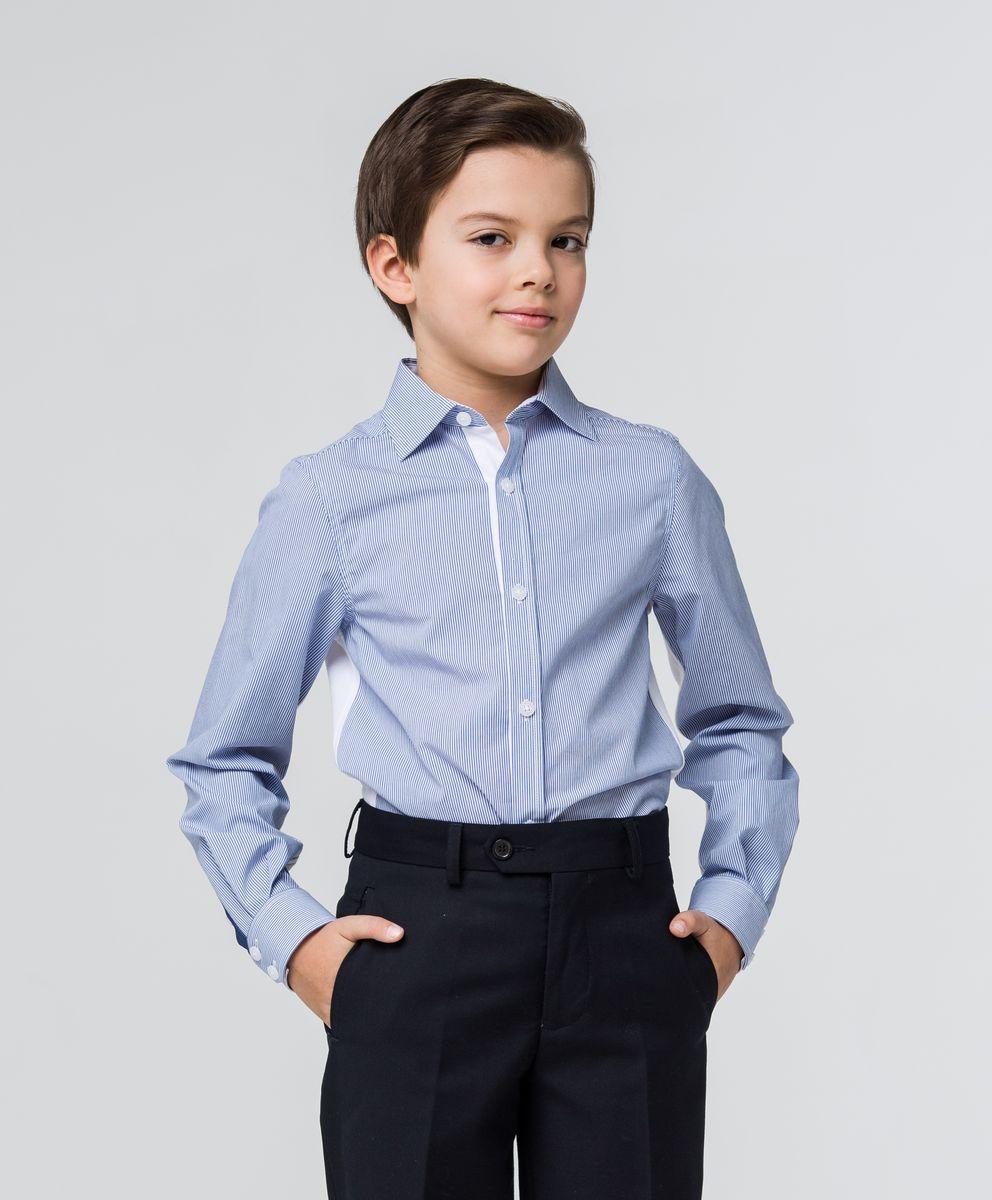 РубашкаSSFSB-629-13836-339Стильная рубашка Silver Spoon станет отличным дополнением к школьному гардеробу вашего мальчика. Модель, выполненная из хлопка с добавлением полиэстера, необычайно мягкая и приятная на ощупь, не сковывает движения и позволяет коже дышать. Рубашка классического кроя с длинными рукавами и отложным воротником застегивается на пуговицы по всей длине. На манжетах предусмотрены застежки-пуговицы. Модель оформлена принтом в полоску. Спинка и рукава модели дополнены трикотажными вставками. Область локтей оформлена декоративными заплатками контрастного цвета.