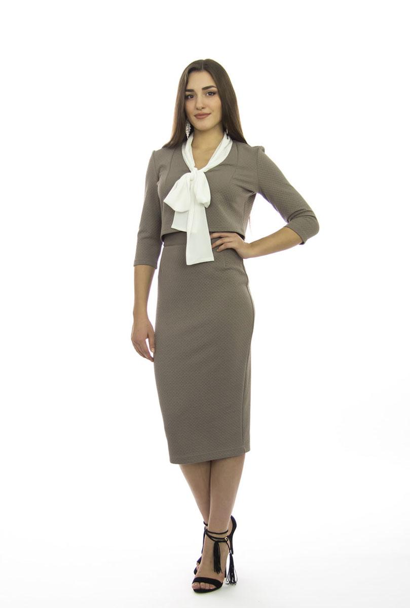 Комплект женский: блузка, юбка. к51к511Шикарный женский комплект Lautus, состоящий из блузки и юбки, станет отличным дополнением к вашему гардеробу. Комплект выполнен из высококачественного материала с оригинальным рельефным рисунком по всей поверхности. Укороченная блузка с воротником-аскот и рукавами 3/4 имеет приталенный крой. Облегающая удлиненная юбка-карандаш, дополненная разрезом сзади, отлично подчеркнет достоинства вашей фигуры. Юбка с высокой посадкой застегивается сзади на потайную застежку-молнию и на пластиковую пуговицу с внутренней стороны. В таком наряде вы непременно привлечете восхищенные взгляды окружающих!