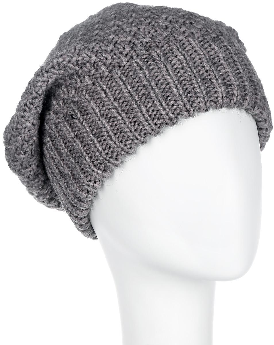 Шапка женская. 42174217Стильная двойная женская шапка Noryalli - теплая модель для холодной погоды. Сочетание различных материалов обеспечивает сохранение тепла и удобную посадку. Шапка выполнена оригинальной вязкой и оформлена кожаной эмблемой с логотипом бренда. Такая шапка - комфортная защита от холода.