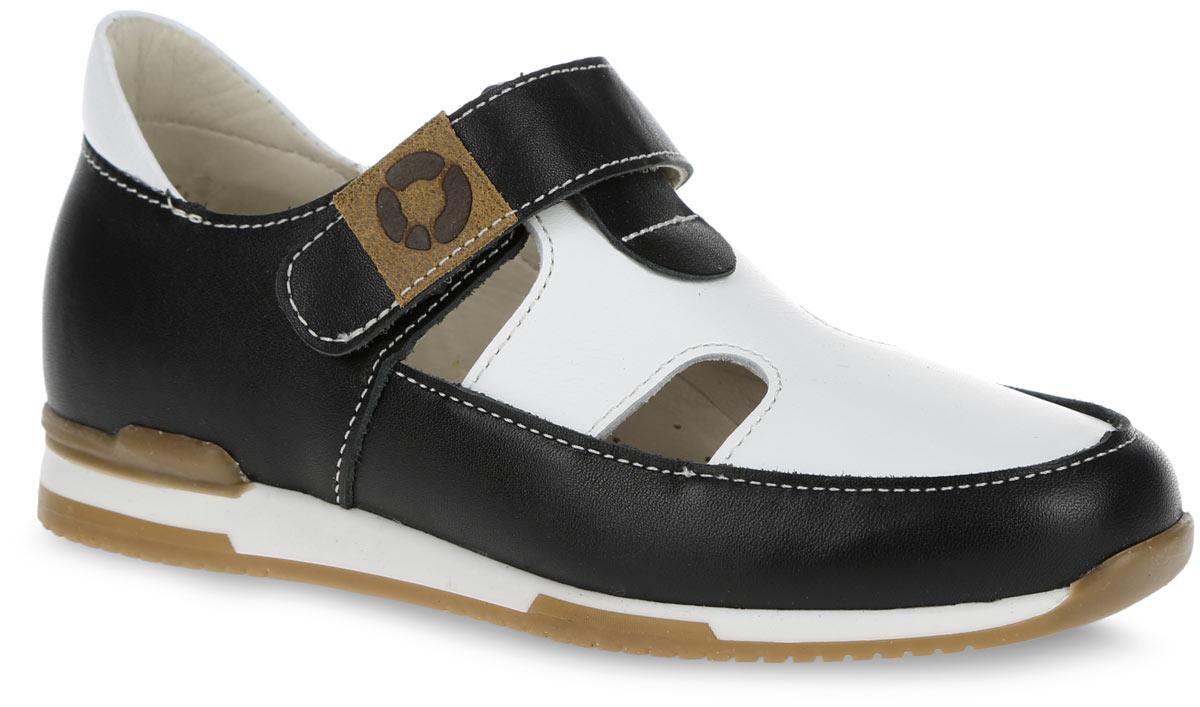 FT-25003.16-OL01O.02Очаровательные туфли от TapiBoo придутся по душе вашему маленькому моднику. Модель выполнена из натуральной кожи контрастных цветов и оформлена по верху светлой прострочкой, в области подъема - резными отверстиями для лучшего воздухообмена, на ремешке - фирменной нашивкой. Подкладка и стелька, изготовленные из натуральной кожи, гарантируют комфорт при ходьбе. Отсутствие швов на подкладке обеспечивает дополнительный комфорт и предотвращает натирание. Многослойная, анатомическая стелька дополнена сводоподдерживающим элементом для правильного формирования стопы. Ремешок на застежке-липучке позволяет легко снимать и надевать обувь даже самым маленьким детям, обеспечивая при этом оптимальную фиксацию стопы. Жесткий фиксирующий задник с удлиненным крылом надежно стабилизирует голеностопный сустав во время ходьбы, препятствуя развитию патологических изменений стопы. Эластичный подносок надежно защищает переднюю часть стопы ребенка, не сжимая пальцы ног и...